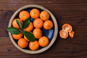 Mandarin Oranges in Bowl on Wood