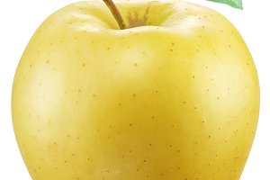 Yellow apple on a white