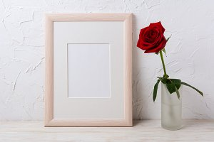 Wooden frame mockup with red rose