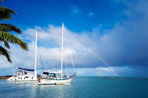 Tropical Rainbow above Sailing Boats