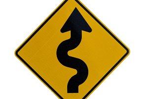 Road sign curves ahead