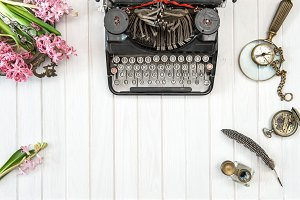 Antique typewriter flowers flat lay
