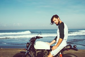 Handsome man siting on motorcycle