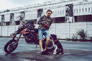Man, motorcycle, dog