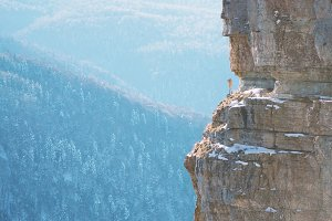 Traveler on the edge of rock.
