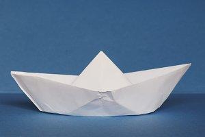 paper boat over blue