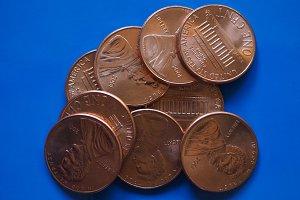 One Dollar Cent (USD) coin, United States (USA) over blue