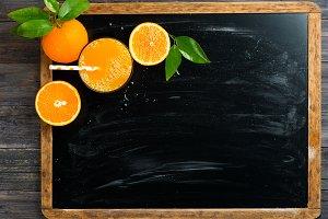 Pressed orange juice on blackboard