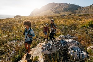 Young people on mountain hike