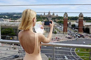 Young girl making photo of Barcelona