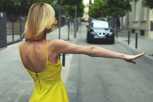 Young girl catching taxi  Barcelona