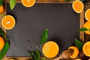 Squeezed orange juice on chalkboard.