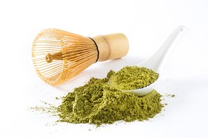Matcha green tea, whisk and spoon