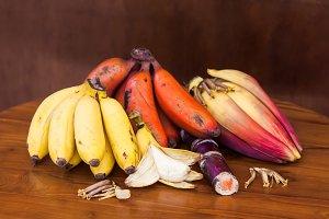 Very fresh banana bunch with unripe banana, wooden table