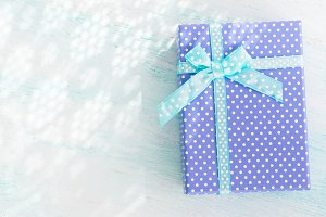 Blue gift box with ribbon pastel background. Fathers day