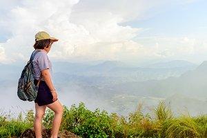 Tourist teen girl poses on mountain