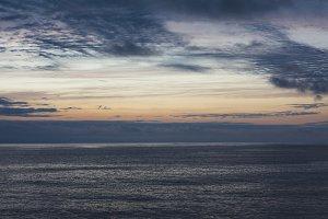 sunlight sunset on horizon ocean