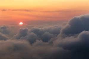 Sun over the clouds at sunrise