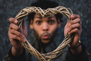 Black man holding a heart