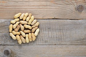 Peanuts on wooden table top view