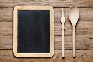 Blackboard, wooden fork and knife