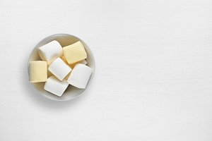 Marshmallow in bowl on white table