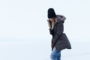 Girl on a background of a white field