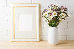 Frame mockup with wild flowers