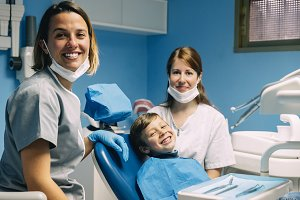 Dentists with a child patient.