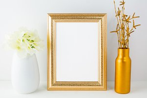 Gold frame mockup with golden vase