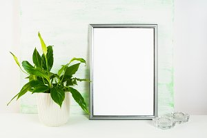 Silver frame mockup with flower pot