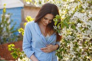 Nice girl in apple blossom