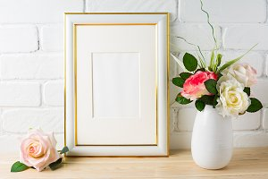 White frame mockup on brick wall