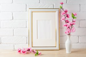 White frame mockup with pink flower