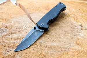 Knife with a black blade.