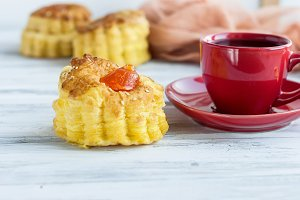 Coffe and flaky pastry with jam