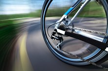 View of rear bicycle wheel in motion