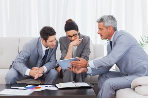 Business people working together on sofa