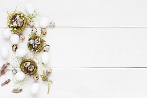 White wooden background with eggs