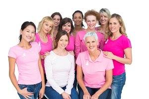Voluntary cheerful women posing and wearing pink for breast cancer