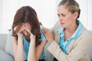Crying woman with her concerned therapist