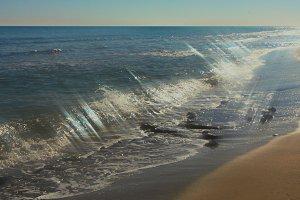 The glittering sea.