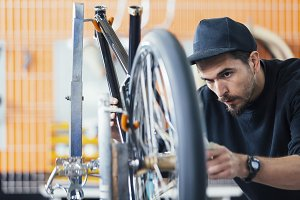 Craftsman works in a bike workshop