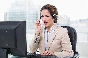 Angry businesswoman shouting in headset