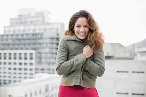 Gorgeous smiling brunette in winter fashion looking at camera