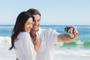 Happy couple taking a photo