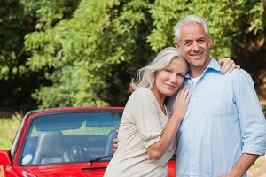 Cheerful mature couple posing