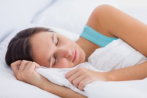 Beautiful brunette sleeping peacefully in bed