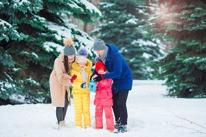Young family outdoors on winter day