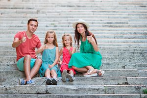 Family vacation in Europe. Parents and kids on Spanish steps in Rome